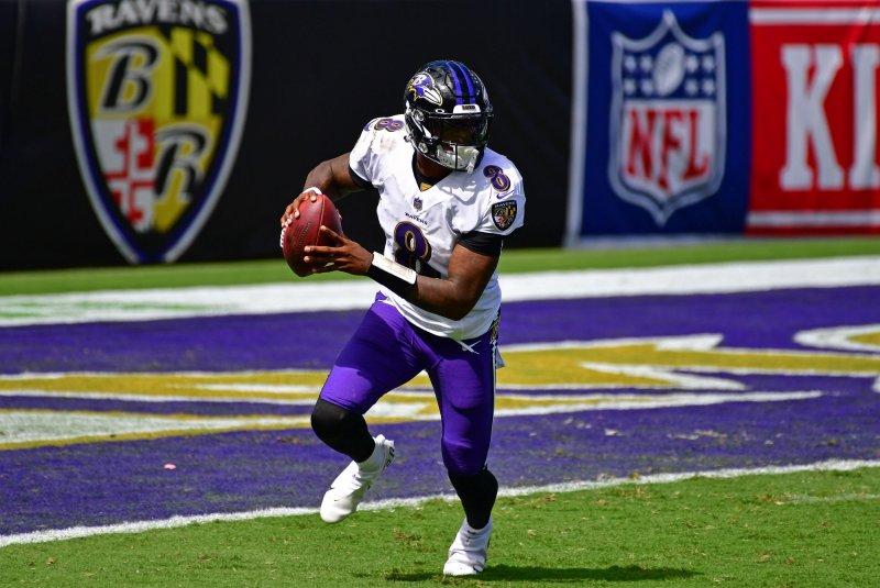 Baltimore Ravens quarterback Lamar Jackson (8) scrambles against the Cleveland Browns during the first half Sunday at M&T Bank Stadium in Baltimore. Photo by David Tulis/UPI