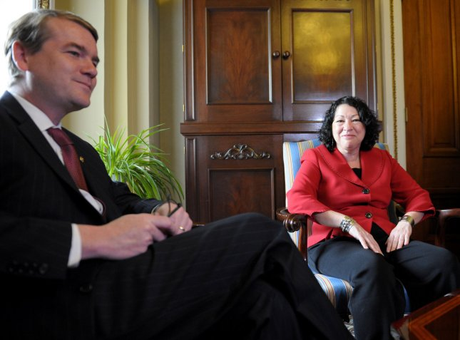Supreme Court nominee Sonia Sotomayor (R) meets with Sen. Michael Bennet (D-CO) in Washington on June 9, 2009. Sotomayor fractured her ankle yesterday after falling at New York's LaGuardia Airport. (UPI Photo/Kevin Dietsch)