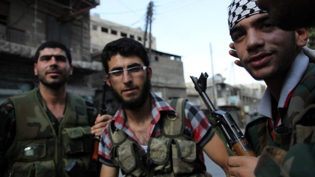 A Syrian rebel fighter stands his position in the Old City of Aleppo. FILE/UPI/Ahmad Deeb