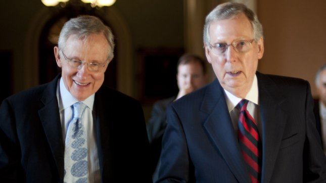 Senate Majority Leader Harry Reid (D-NV) (L) and Senate Minority Leader Mitch McConnell (R-KY) walk into McConnell's office as the Senate continues negotiations on the debt ceiling in Washington on July 31, 2011. UPI/Kevin Dietsch