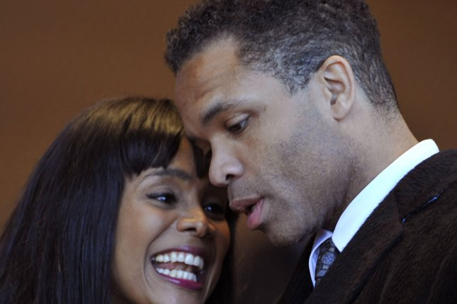 Former U.S. Rep. Jesse Jackson Jr. (D-IL) (R) and talks with his wife, former Chicago Ald. Sandi Jackson. He will be released from prison Thursday after serving time for illegal use of campaign funds. UPI/Brian Kersey
