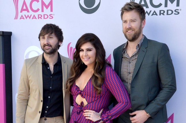 Dave Haywood, Hillary Scott and Charles Kelley (L-R) of Lady Antebellum attend the Academy of Country Music Awards on April 2. Scott confirmed Friday that she's expecting twins with husband Chris Tyrrell. File Photo by Jim Ruymen/UPI