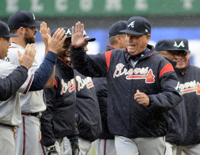 Atlanta Braves manager Brian Snitker greets his players before the start of a game against the Pittsburgh Pirates. Photo by Archie Carpenter/UPI