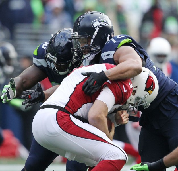 Seattle Seahawks defensive end Michael Bennett assists on a sack of Arizona Cardinals quarterback Carson Palmer during a game in 2016. Photo by Jim Bryant/UPI