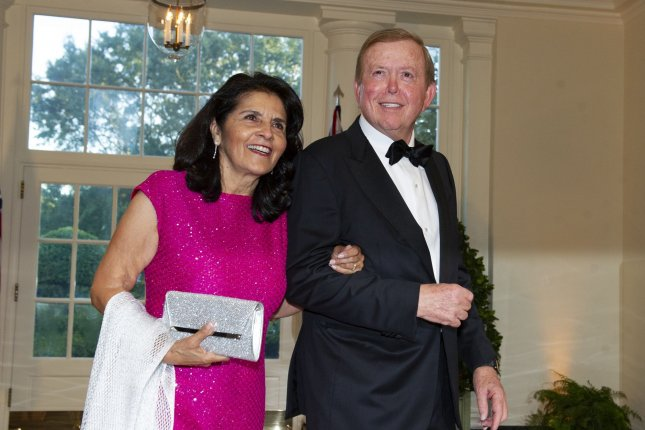 Lou Dobbs and Debi Dobbs arrive for the state dinner hosted by President Donald Trump and first lady Melania Trump in honor of Prime Minister Scott Morrison of Australia and his wife, Jenny Morrison, at the White House in Washington, D.C., on September 20, 2019. Fox Business canceled Lou Dobb's show Friday. File Photo by Ron Sachs/UPI