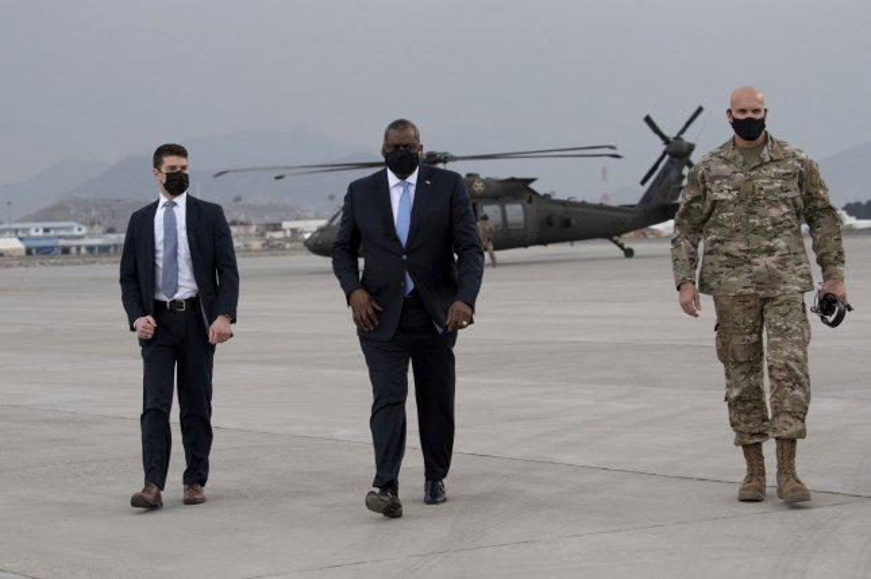 Secretary of Defense Lloyd J. Austin III walks with the commander of Combined Security Transition Command – Afghanistan, Army Lt. Gen. E. John Deedrick Jr., before departing Kabul, Afghanistan, Sunday. Photo by Lisa Ferdinando/DoD/UPI