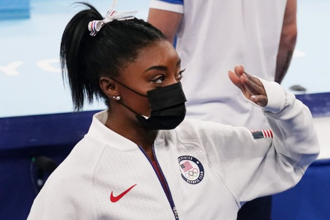 Simone Biles watches her team practice after pulling out of the women's team final at the 2020 Summer Games on Tuesday in Tokyo. Photo by Richard Ellis/UPI