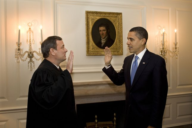 Chief Justice John G. Roberts Jr. administers the oath of office a second time in the Map Room of the White House on January 21, 2009. In what White House counsel Greg Craig called an abundance of caution, a inauguration day mistake in word order was corrected. (UPI Photo/Pete Souza/The White House)