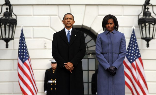 U.S. President Barack Obama and first lady Michelle Obama observe a moment of silence Jan. 10, 2010, to honor the victims of a shooting attack in Arizona two days earlier. UPI/Roger L. Wollenberg