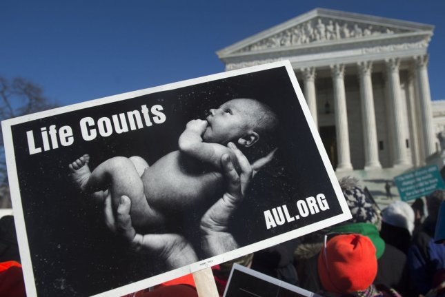 Anti-abortion protesters take part in March for Life on Capitol Hill in Washington, D.C., January 22, 2014. The march marks the 41st anniversary of the 1973 Supreme Court decision in the famed Roe v. Wade case that affirmed a woman's right to an abortion. UPI/Kevin Dietsch