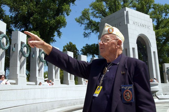 Mitsubishi will apologize for using U.S. prisoners of war as forced labor in its mines during World War Two. About 500 American POWs were forced to work in four mines operated by Mitsubishi's predecessor firm. Pictured: Henry Hank Wilayto explores the World War II memorial on the Mall in Washington. Hank fought in the Phillipines, but was captured and held as a POW for about 3 1/2 years. File Photo by Roger L. Wollenberg/UPI