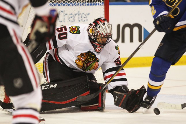 Chicago Blackhawks goaltender Corey Crawford reaches for a loose puck after a St. Louis Blues shot in the first period at the Scottrade Center in St. Louis on March 9, 2016. Photo by Bill Greenblatt/UPI