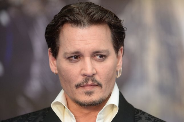 Johnny Depp attends the premiere of Alice Through The Looking Glass at Odeon, Leicester Square in London, on May 10, 2016. Depp has signed on to star in upcoming hip-hop crime drama, Labyrinth. File Photo by Rune Hellestad/ UPI