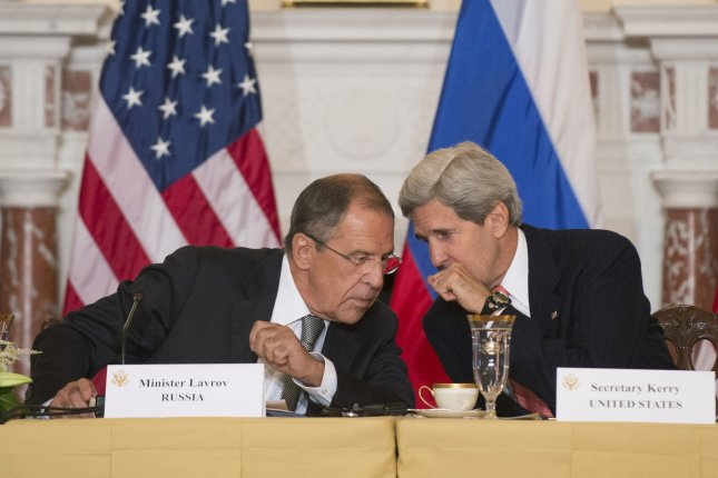 U.S. Secretary of State John Kerry (right) whispers to Russian Foreign Minister Sergey Lavrov during a meeting at the State Department. Wednesday, U.S. and Russian officials said Kerry and Lavrov will meet in Switzerland on Saturday to begin new talks aimed at bringing peace to Syria. Negotiations broke down weeks ago after a cease-fire failed after just six days. File Photo by Kevin Dietsch/UPI