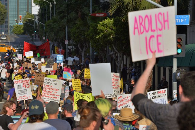 Hundreds march to the Metropolitan Detention Center to protest federal immigration policy on Thursday in Los Angeles. Photo by Jim Ruymen/UPI