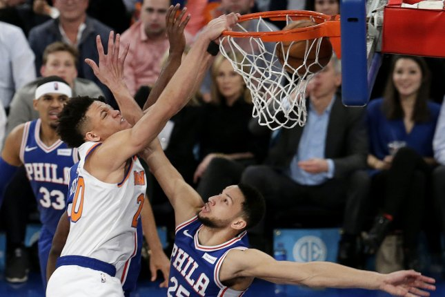 New York Knicks rookie Kevin Knox threw down a huge dunk on Philadelphia 76ers star Ben Simmons during the first half of a loss Wednesday at Madison Square Garden in New York City. Photo by John Angelillo/UPI
