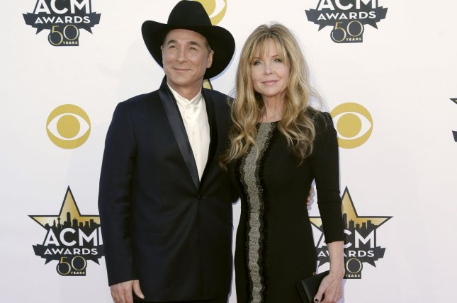Clint Black (L) and Lisa Hartman Black were eliminated on Wednesday's edition of The Masked Singer. File Photo by John Angelillo/UPI