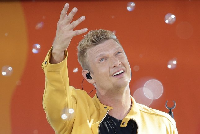 Nick Carter and his wife, Lauren Carter, shared their surprise after announcing they're expecting their third child. File Photo by John Angelillo/UPI