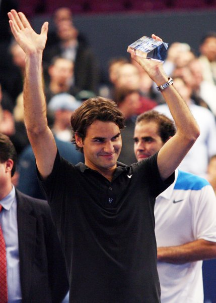 Roger Federer holds up his trophy after defeating Pete Sampras at the Netjets Showdown at Madison Square Garden in New York City on March 10, 2008. Federer defeated Sampras in a third set tie-break to win the match. (UPI Photo/John Angelillo)