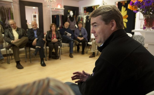 U.S. Senator Michael Bennet gestures during a small town meeting at Stella B's boutique on October 27, 2010 in Arvada, Colorado. Sen. Bennet is running even with Republican challenger Ken Buck. UPI/Gary C. Caskey