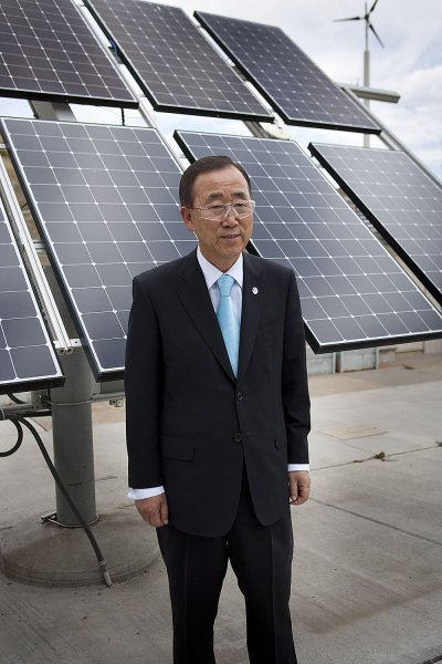 UN Secretary General Ban Ki-moon stands for a picture in front of a solar panel display with a wind turbine in the distance while on a visit at the National Renewable Energy Labs (NREL) on August 24, 2011 in Golden, Colorado UPI/Gary C. Caskey