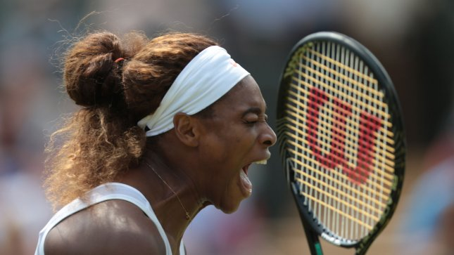 Serena Williams reacts as she wins a point during her match against Caroline Garcia on day four of the 2013 Wimbledon Championships in London on June 26, 2013. UPI/Hugo Philpott