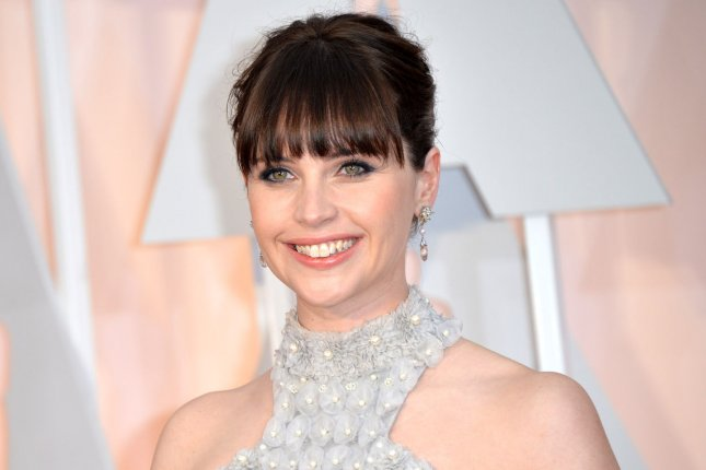 Felicity Jones arrives on the red carpet at the 87th Academy Awards on February 22, 2015. Jones is seen attempting to steal the plans to the Death Star in the new story trailer for Rogue One: A Star Wars Story. FIle Photo by Kevin Dietsch/UPI