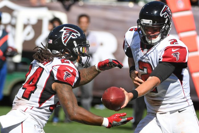 Atlanta Falcons QB Matt Ryan (R) hands off the ball to Devonta Freeman in the third quarter against the Oakland Raiders at the Coliseum in Oakland, California on September 18, 2016. The Falcons defeated the Raiders 35-28. Photo by Terry Schmitt/UPI