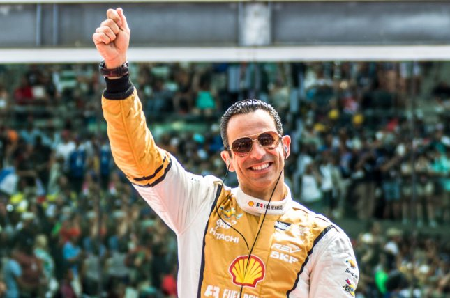 Helio Castroneves waves to the crowd during introductions for the 2017 Indianapolis 500, at the Indianapolis Motor Speedway on May 28, 2017 in Indianapolis, Indiana. File photo by Edwin Locke/UPI