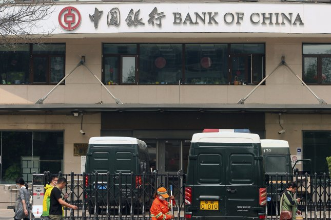 Chinese walk past a Bank of China branch in Beijing on April 18, 2019. U.S. banks, once considered the most powerful in the world, are now ranked second to China's massive banking system. The top four banks in the world are from China, according to the latest annual rankings by S&P Global Market Intelligence. In order of size: Industrial and Commercial Bank of China (ICBC), China Construction Bank, Agricultural Bank of China (ABC) and Bank of China. Photo by Stephen Shaver/UPI