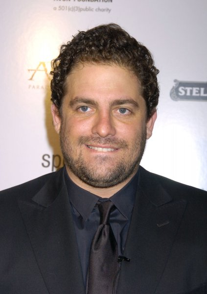 Director Brett Ratner poses for photographers at the New York premiere of After The Sunset on November 9, 2004 at the Ziegfeld Theatre in New York City. (UPI Photo/Robin Platzer)
