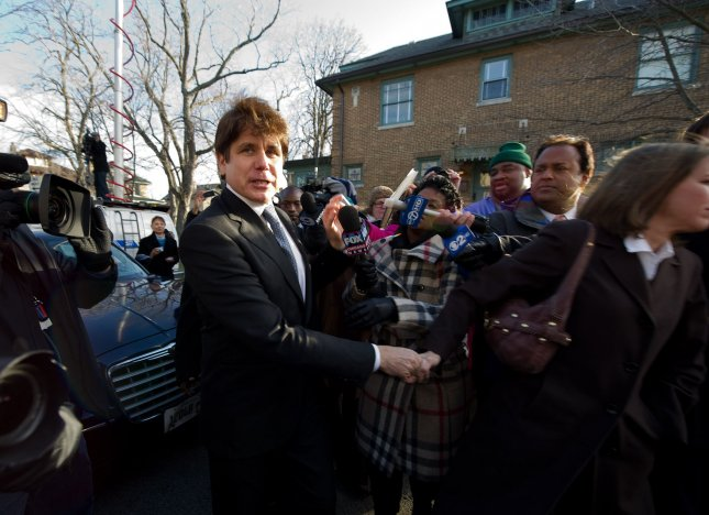 A federal judge Monday rejected former Illinois Gov. Rod Blagojevich's motion for a new trial, calling it hare-brained. Pictured here after his Dec. 7 sentencing. UPI/Brian Kersey