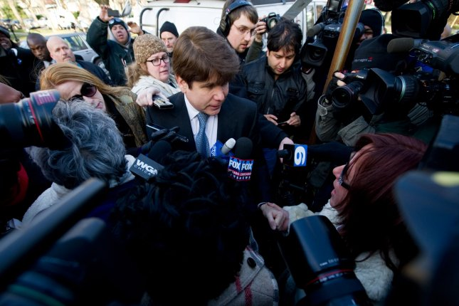 Former Illinois Gov. Rod Blagojevich shakes hands with a supporter as he arrives at his home after being sentenced to 14 years in federal prison on December 7, 2011 in Chicago. Blagojevich had been previously convicted of 18 criminal counts involving the attempted sale of a U.S. Senate seat, illegal shakedowns for campaign funds and lying to federal agents UPI/Brian Kersey