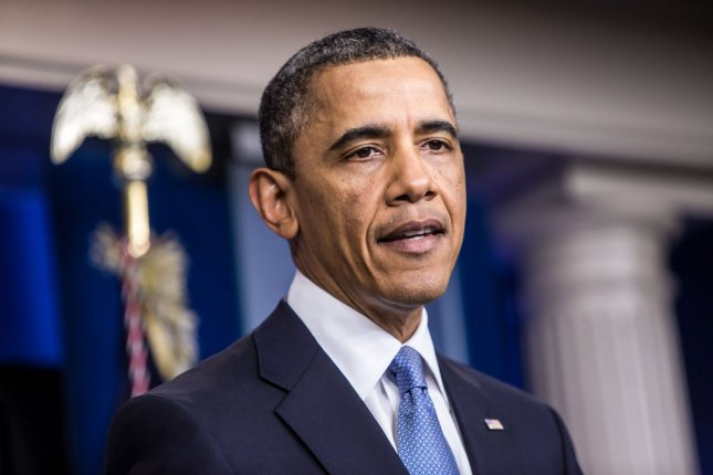 Obama signs defense act, but has doubts