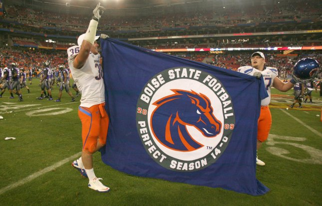 Boise State players hold up a flag as the Texas Christian University team leaves the field after the Broncos defeated the Horn Frogs 17-10 in the Fiesta Bowl at University of Phoenix Stadium in Glendale, AZ, January 4, 2010. UPI/Art Foxall