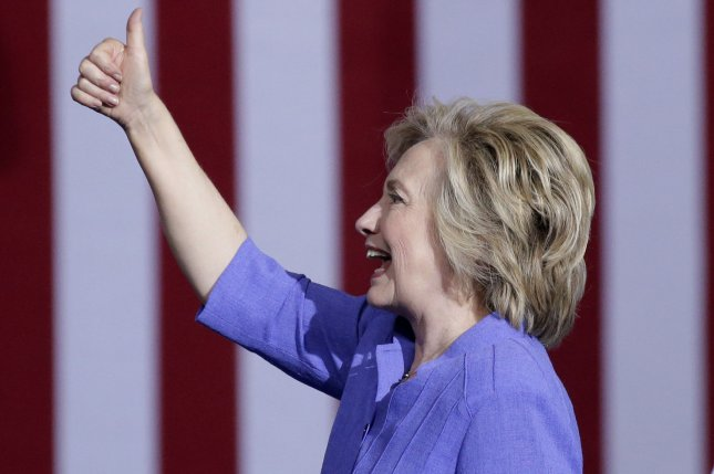 Democratic presidential candidate Hillary Clinton gives a thumbs up after a speech with Vice President Joe Biden at Riverfront Sports in Scranton, Pa., on August 15. Friday, a federal judge ruled that the former secretary of state will not have to give a deposition as part of a Freedom of Information Act lawsuit brought by the conservative group Judicial Watch. She will, though, have to answer their questions in writing. Photo by John Angelillo/UPI