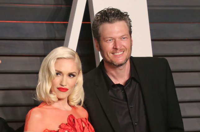 Blake Shelton (R) and Gwen Stefani attend the Vanity Fair Oscar party on February 28, 2016. The country star thinks Stefani and Alicia Keys will ultimately return to The Voice. File Photo by David Silpa/UPI