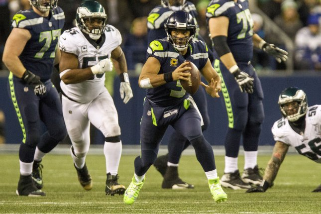 Seattle Seahawks quarterback Russell Wilson (3) scrambles against the Philadelphia Eagles during the second quarter on December 3, 2017 at CenturyLink Field in Seattle, Washington. Photo by Jim Bryant/UPI