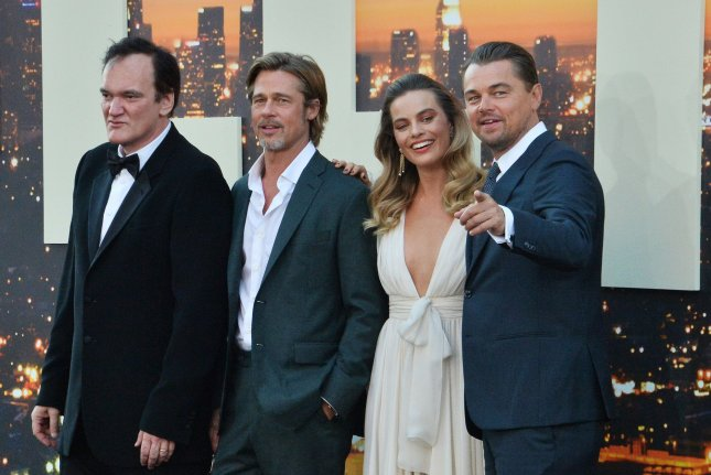 Director-writer Quentin Tarantino is joined by cast members Brad Pitt, Margot Robbie and Leonardo DiCaprio at the premiere of Once Upon a Time in America in Los Angeles on July 22. Photo by Jim Ruymen/UPI