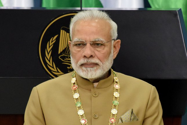 Indian Prime Minister Narendra Modi Tuesday celebrating the passing of a law that outlawed the Muslim instant divorce practice. Photo by Debbie Hill/UPI