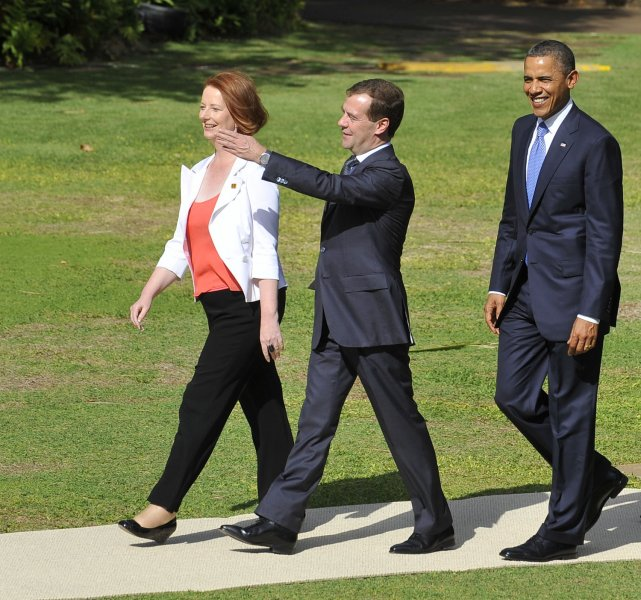 U.S. President Barack Obama (R) with Australian Prime Minister Julia Gillard and Russian President Dmitry Medvedev arrive for the family photo during the Asia-Pacific Economic Cooperation summit (APEC) Summit in Honolulu, Hawaii on November 13, 2011. UPI