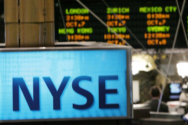 An electronic signboard, top, displays the numbers from the international markets at the New York Stock Exchange after the Dow Jones Industrial Average dipped 800 points on the previous day as markets plunged globally on October 7, 2008 in New York City. (UPI Photo/Monika Graff)