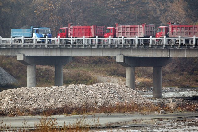 Empty dump trucks are pictured waiting to enter North Korea to be filled with iron ore, a popular destination for iron ore smugglers from South America. (UPI Photo/Stephen Shaver)