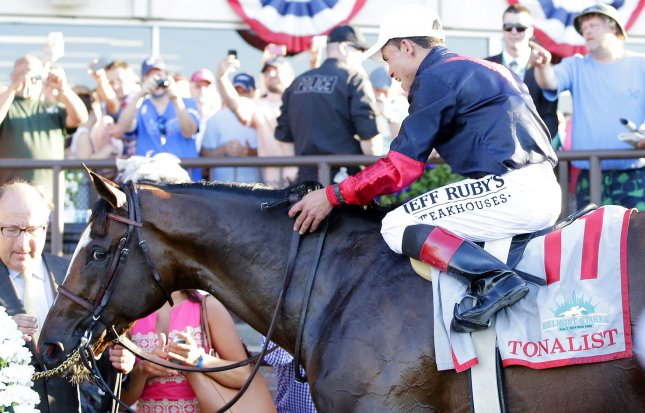 Tonalist and Jockey Joel Rosario celebrate in the winners circle after they beat Commissioner by a head at the finish and win the 146th running of the Belmont Stakes in Elmont New York on June 7, 2014. California Chrome came in fourth place and failed to become the first horse in 36 years to win the Triple Crown. UPI/John Angelillo