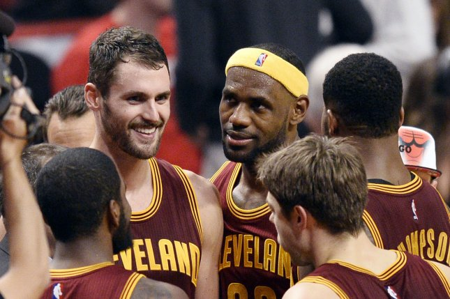 Cleveland Cavaliers forward LeBron James, center, talks to forward Kevin Love, left, after a loss to Indiana. Photo by Brian Kersey/UPI