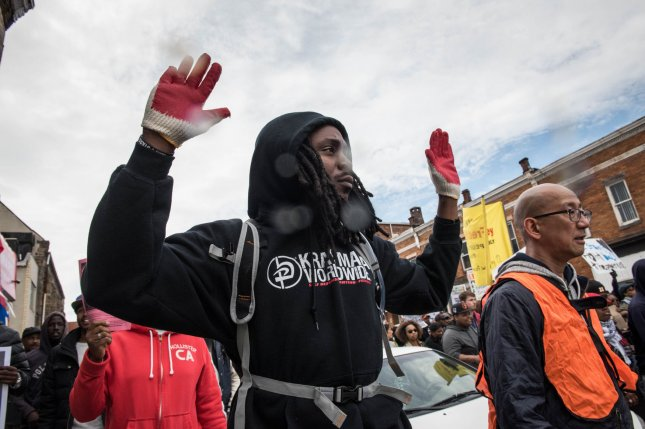 Thousands of people march through the streets of Baltimore, Maryland during a demonstration on April 25, 2015 to protest the mistreatment and ultimate death of Freddie Gray while in police custody. Gray, 25, was arrested on April 12 and died of unexplained spinal injuries while in a police van. Photo Ken Cedeno/UPI