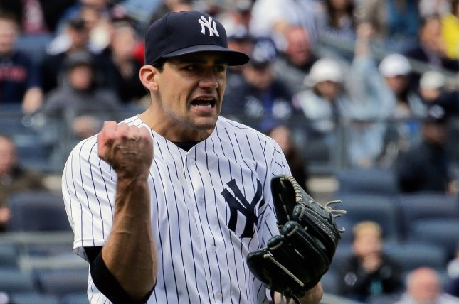 b814bb2a1 New York Yankees starting pitcher Nathan Eovaldi reacts as Boston Red Sox  designated hitter David Ortiz hits into a double-play in the fifth inning of  their ...