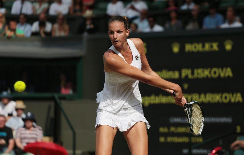 Karolina Pliskova hits a return against Magdalena Rybarikova during their Wimbledon match last month. Photo by Hugo Philpott/UPI.