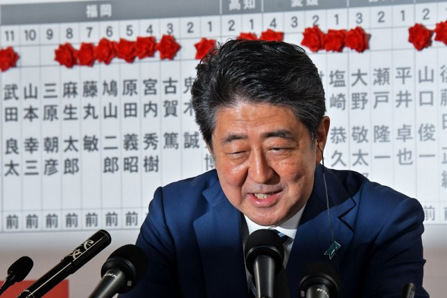 Shinzo Abe, President of Liberal Democratic Party of Japan, answers reporter's question during the ballot counting ceremony for the parliamentary lower house elections in Tokyo, Japan, on Sunday. Photo by Keizo Mori/UPI