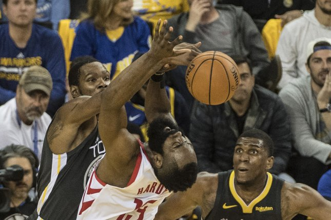 625390b8732 Houston Rockets guard James Harden (C) missed a big portion of the first  quarter after sustaining an eye injury in a game against the Golden State  Warriors ...